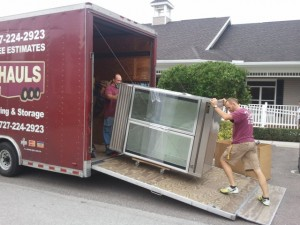 Loading a heavy large item into the moving trailer